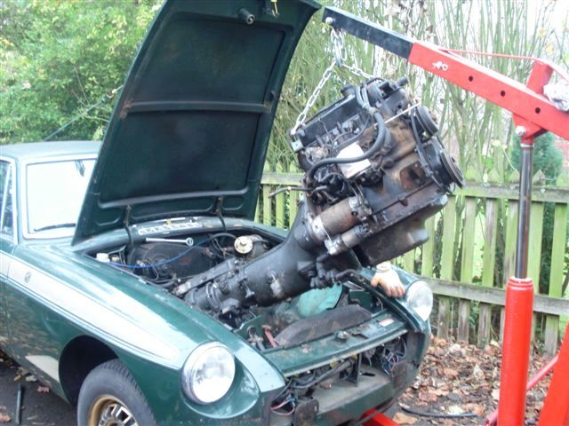 The old engine and gearbox almost out leaving a nice empty engine bay to prepare ready for the V8